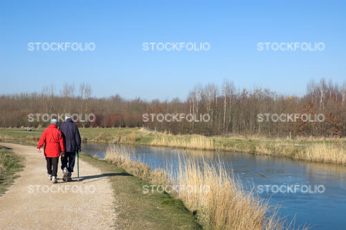 Senior couple walking along a canal towpath