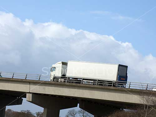 Truck on a motorway with copy space