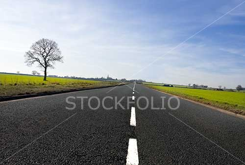 Open road stretching out to the horizon with diminishing perspective