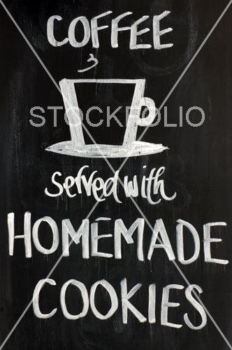 Blackboard sign Coffee served with homemade cookies