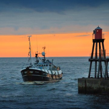 Fishing boat Advance at the entrance to Whitby harbour