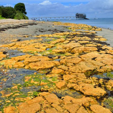 Looking over rocks to Bembridge lifeboat station
