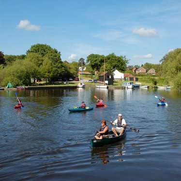 Canoeing at Barton Turf, Norfolk Broads